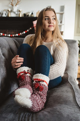 A teenage girl at home at Christmas time