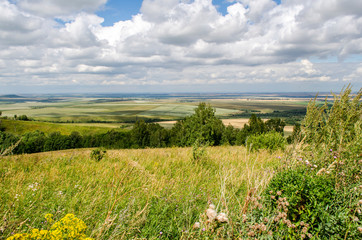 View from the beginning of the Altai mountains to the vast expanses of fields