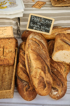 Fresh traditional french bread selling on a marketplace