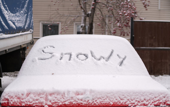 word snowy on the snowy car in the first day of winter