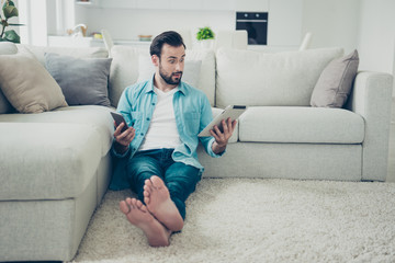 Full legs body size brunet hair bearded man hold gadget in hands