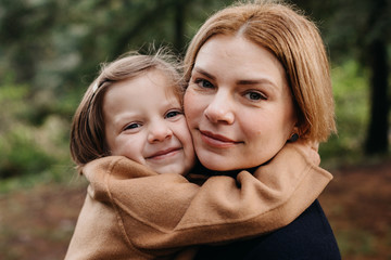 Daughter Sweetly Embracing Mother