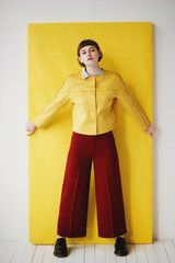 Direct view of girl in yellow jacket and maroon pants wearing