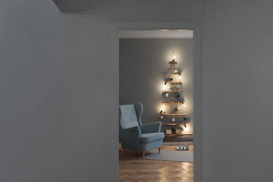 Minimal handmade  Christmas tree  in the living room