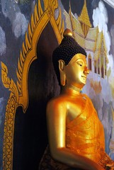 Golden Buddha sculpture in public temple, Thailand.