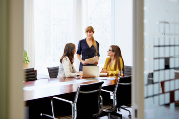 Confident Businesswomen Discussing At Table
