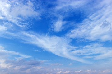 Beautiful clear blue sky background with white clouds.