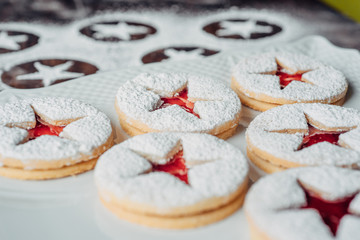 Linzer Christmas cookies on a white plate