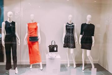 Mannequins Standing In Store Window Display Of Women's Casual Cl
