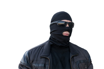 the criminal in the black balaclava and glasses on an isolated background