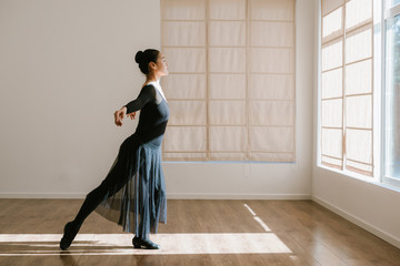 Young professional dancer practicing in a studio