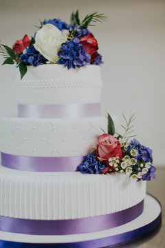 Colorful purple and white designer wedding cake