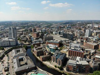 Aerial photo overlooking Leeds City Center in West Yorkshire showing buildings and businesses