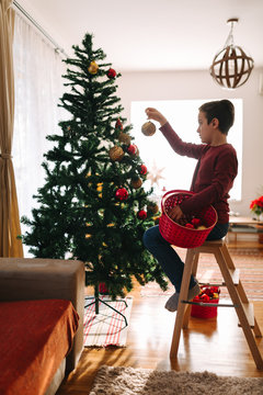 Boy decorating at home