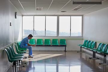 Doctor resting alone in a hospital waiting room.