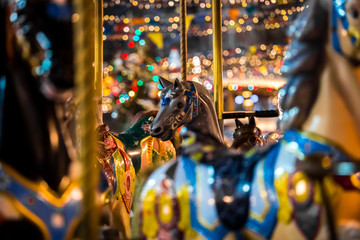 Carousel with rocking horses on christmas market in Moscow, Russia