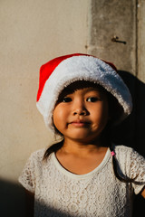 Asian girl wearing a Christmas hat