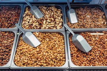 Bins with various candied nuts