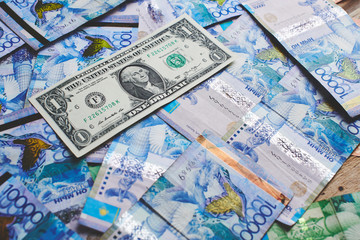 Tenge. Kazakh money and dollars. Background of the money.