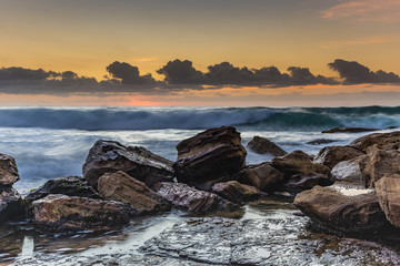 Waves and Rocks at Sunrise