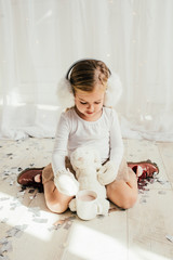 Girl Playing With Her Bunny Toy