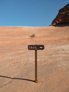 Sign for hiking trail in stone within Arches National Park in Utah.