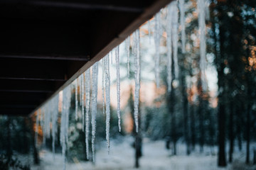Icicles hanging from the eves of a porch roof.