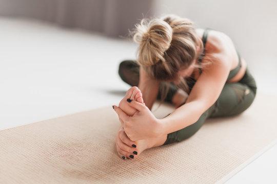 Young woman performing Janusirsasana exercise