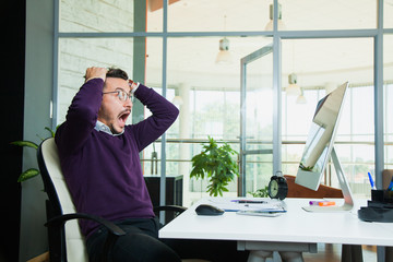 Excited embarraced businessman scream at office in horror