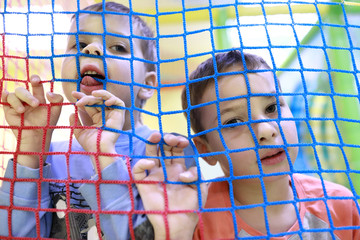 Children in toy cage