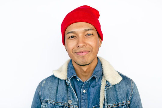 Latin young man wearing denim outfit over white background.