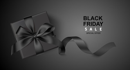 Wall Mural - Decorative black gift box with long ribbon on black background. Black friday sale design template. Vector illustration