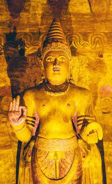 Golden underground standing Buddha statue