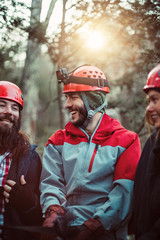 Friends laugh and joke during an outdoor zip line course