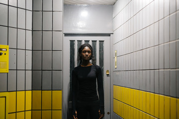 Sportive woman standing in hall