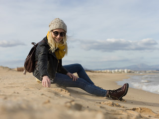 Pretty woman taking sand on beach