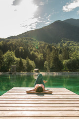 Woman Doing Yoga on Mountain Lake
