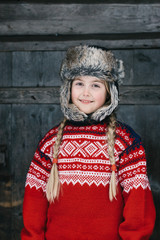 Outdoor Winter Portrait of Cute Norwegian Girl in Traditional Kn