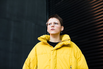 Portrait of woman with short hair and yellow parka