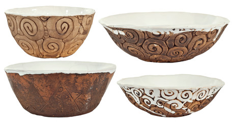 Clay handmade is isolated on a white background. Ceramic products with drawings and patterns. Set of several objects.