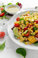 Sweet Corn salad with tomatoes, avocado, red onion, herbs and lime