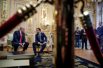 U.S. President Donald Trump and French President Emmanuel Macron meet at Elysee presidential palace, in Paris