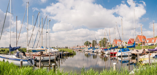Marina with sailboats in dike village Durgerdam, IJmeer, Amsterdam, Netherlands