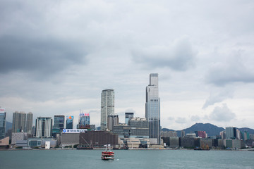 Landscape and cityscape and Star Ferry crossing Victoria Harbour between kowloon and Hong Kong island