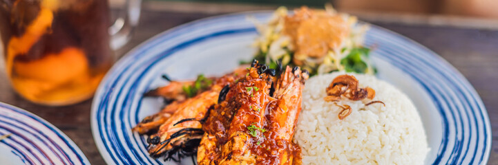 Close up Grilled prawns or fresh grilled shrimps ,cooking seafood with rice. Bali Kitchen BANNER, LONG FORMAT
