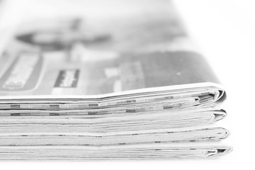 News. Stack of newspapers and magazines isolated on white background, side view