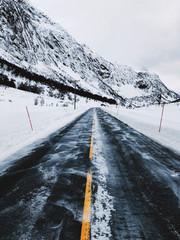 Driving Norway - Road Through Mountainous White Winter Landscape