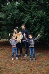 Fun Portrait of Family with Boys Jumping