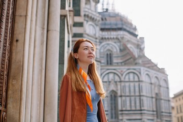 Lovely girl in dreamy mood posing by the Duomo in Florence