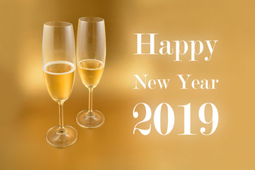 Happy New Year 2019 illustration. Glass with champagne on a golden background. Festive golden background. New Year toast